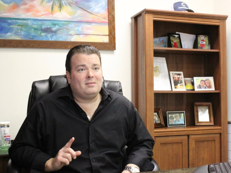 Tom Gavin IV talks about the CannaCard at the CannaTrac offices in suburban Palos Heights. (One Illinois/Ted Cox)