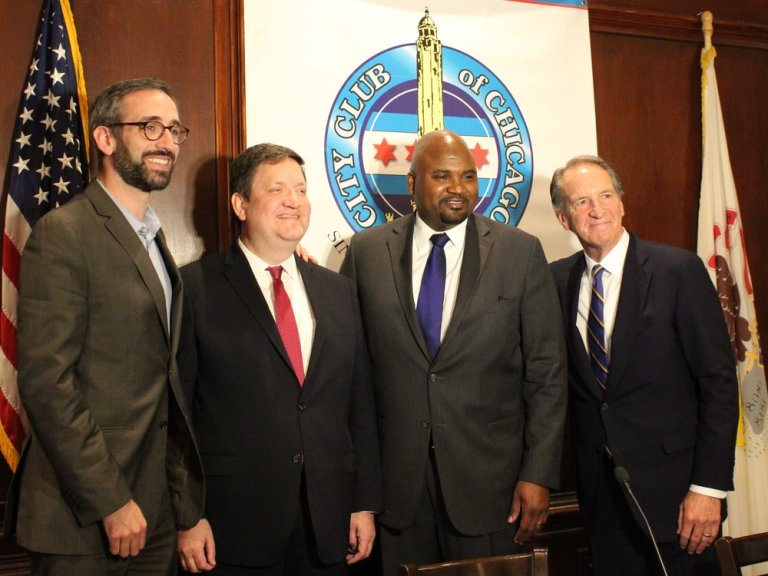 Reps. Will Guzzardi and David McSweeney and Sens. Elgie Sims and Chuck Weaver come together for a photo after Monday's tax forum. (One Illinois/Ted Cox)