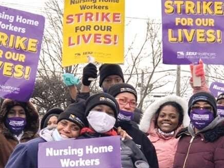 SEIU Healthcare Illinois workers cheer a new agreement reached with Infinity late Friday: 99 percent of union members voted to ratify over the weekend. (Facebook)